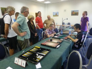 Spectators admiring the skills of the blind British player, Yan Kit Chan (on the right).